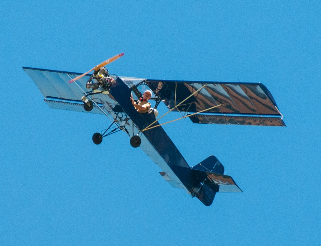 Belite's Tricycle Ultralight Aircraft flies over.  Blue on blue, nice?!