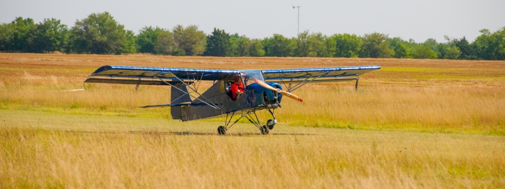 takeoff of blue ultralight tricycle gear airplane from Belite.
