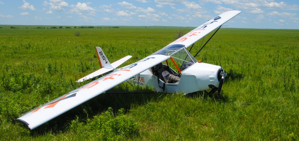 A damaged ultralight airplane after a taxiing incident in the Flint Hills.